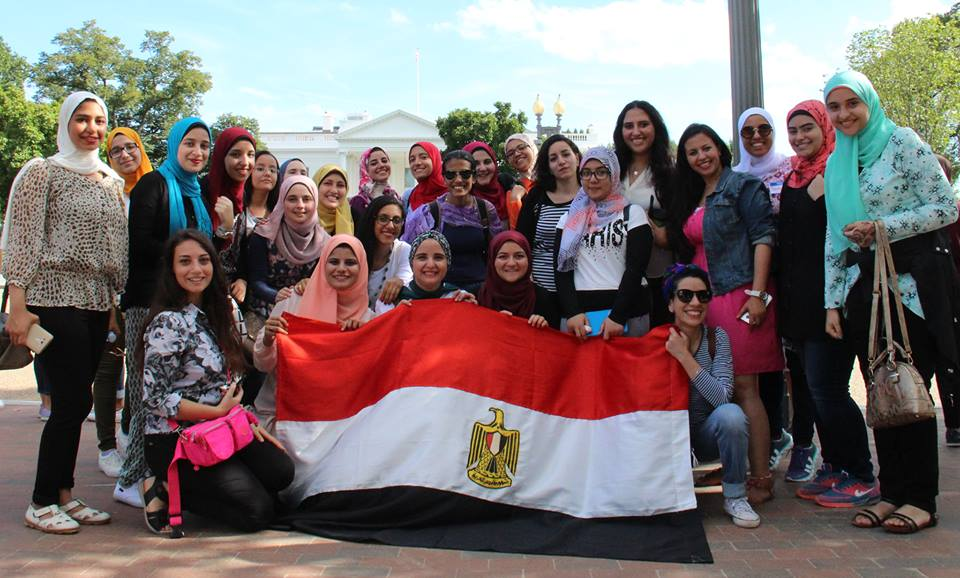 HEI Students pose behind Egypt flag